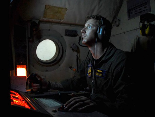 Naval Aircrewman Operator 2nd Class Matthew Bailey of Patrol Squadron Forty on Duty